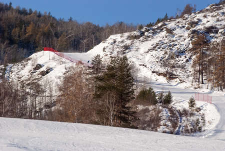 The ski slope passing among trees on a slope