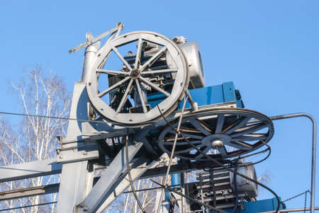 The ropeway engine against the background of the sky Stock Photo