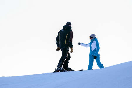 Mountain skiers choose the route for descent