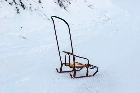 The sledge for children with a back on snow