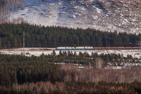 The train in mountains in the winter