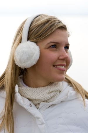 ear muffs: Smiling beautiful girl in ear muffs