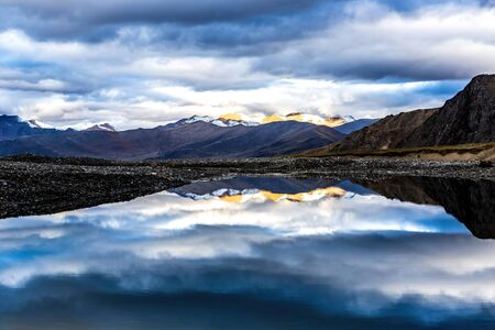 the reflection of Meili Snow Mountains in the morning