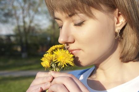 girl and dandelions photo