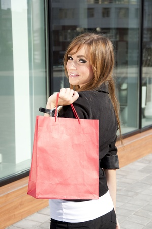 beautiful woman with shopping bags on the street photo