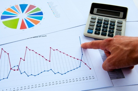 specifies: The mans hand specifies the chart of growth, fot business collage Stock Photo