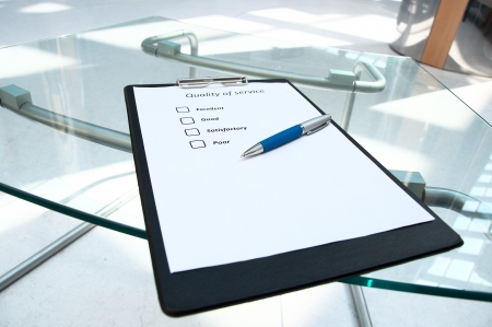 The questionnaire with marks about quality of service on a desktop
