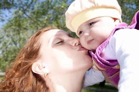 Portrait Beautiful mum kisses the child Stock Photo - 9910333