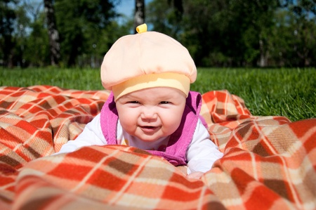 coverlet: The portrait of the kid, lays on on a coverlet Stock Photo