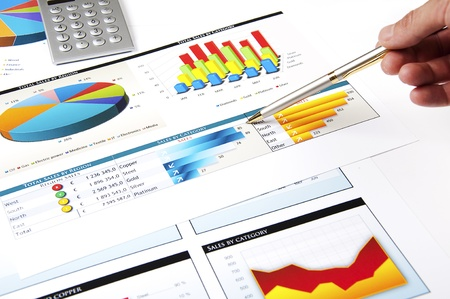 specifies: hand with the handle specifies charts of growth, finance business collage Stock Photo