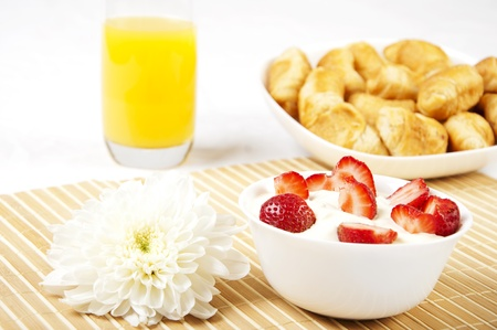 concept Breakfast: orange juice, croissants and Berries on a table photo