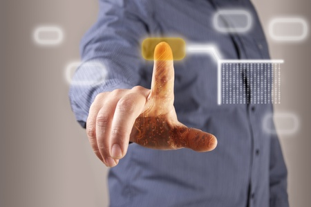 technology metaphor: hand pushing a button on a touch screen interface, blur man background