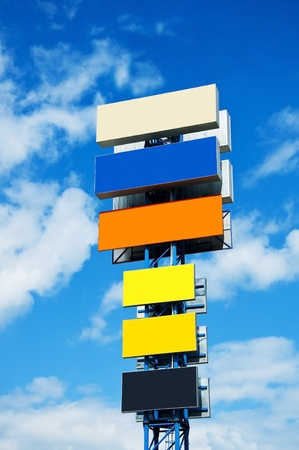 ulti-coloured billboard on a background of the blue sky with clouds photo
