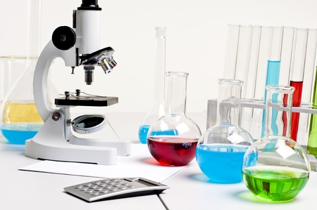 workplace employee lab,flasks with colored liquids, laboratory items