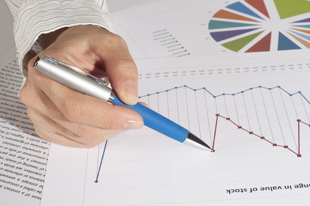 specifies: hand with pen specifies charts of growth