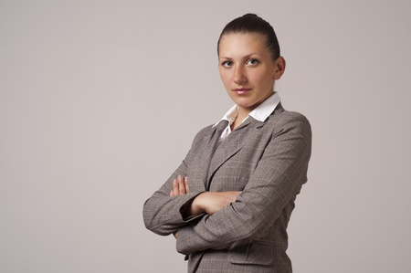 to fold one's arms: Portrait of a happy young business woman, fold ones arms