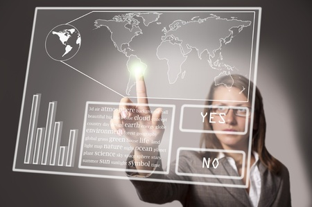 advanced: eautiful woman touches the touch screen on which there is a map of the world Stock Photo