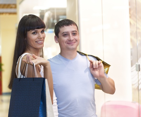 couple discuss purchases in shopping center, they are happy photo