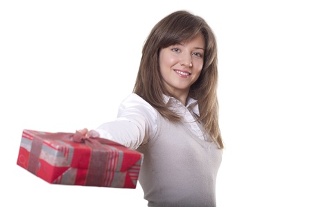 Young smiling woman holding gift - Red box with a bow photo