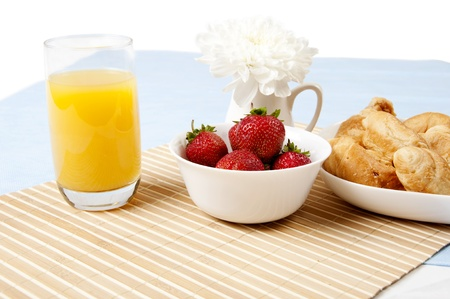 light Breakfast: orange juice, croissants and Berries on a table photo