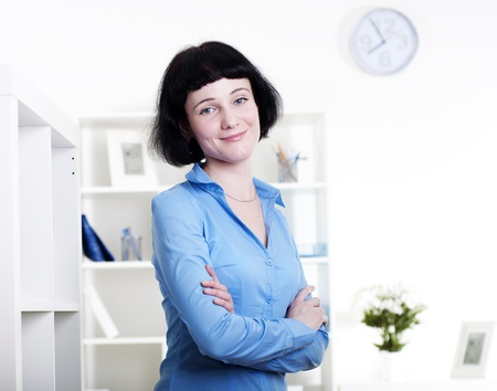 Portrait of a business woman in the office, dreams Stock Photo - 11549867