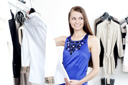 young Beautiful woman in mall buying clothes Stock Photo - 11746640