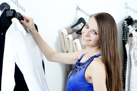 young Beautiful woman in mall buying clothes Stock Photo - 11746681