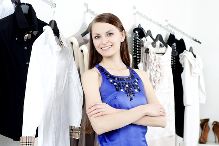 young Beautiful woman in mall buying clothes Stock Photo - 11746642