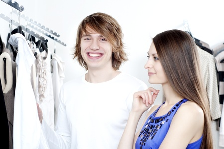 cute man and the woman in shop choose clothes Stock Photo - 11746632