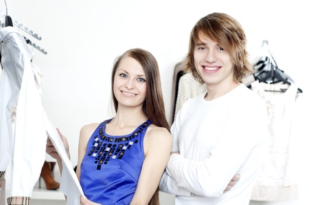cute man and the woman in shop choose clothes Stock Photo - 11746620