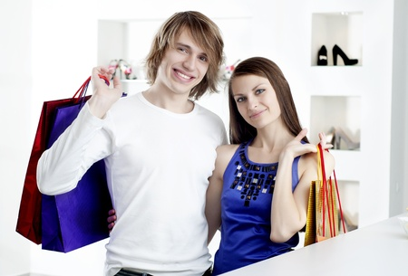 cute man and the woman in shop hugging Stock Photo - 11746624