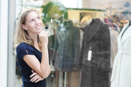 young Beautiful woman in mall think about shopping Stock Photo - 11746688