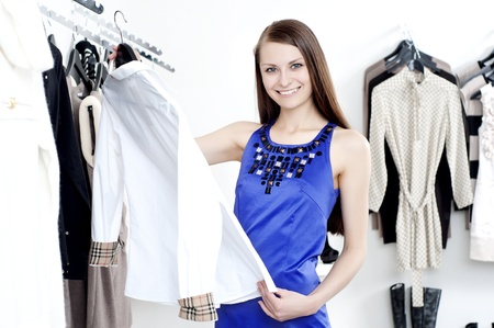 young Beautiful woman in mall buying clothes Stock Photo - 12328226