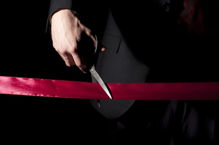 man in a suit, cuts a red tape, opening of event Stock Photo - 12328246
