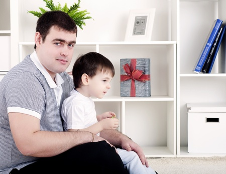 Father and son spend time together, playing at home photo