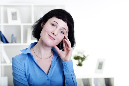 Portrait of a business woman in the office, dreams Stock Photo - 12596930