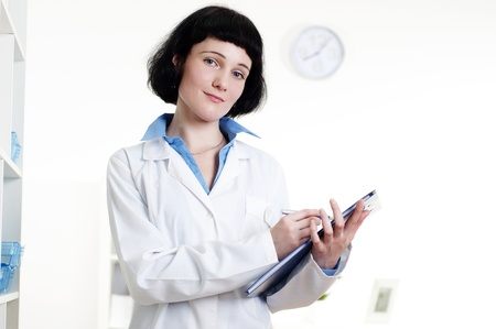 doctor with a tablet, does a note photo