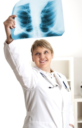 Female medic looking at x-rays photo