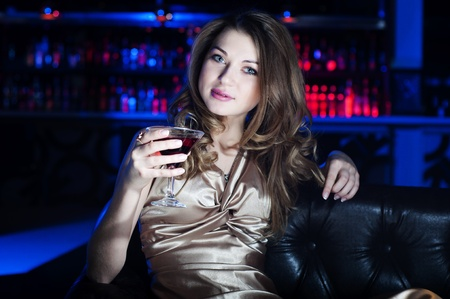 coctail: Portrait of the young beautiful woman, rest in bar