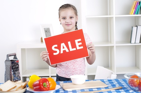 girl holding sale sign Stock Photo - 12939608