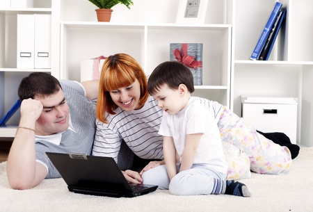 family looking at a laptop Stock Photo - 13037118