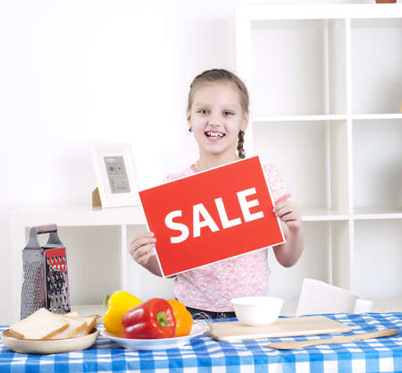 girl holding sale sign Stock Photo - 13233937