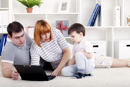 family looking at a laptop Stock Photo - 13428570