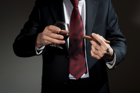 whisky bottle: rich person, holds a cigar and whisky