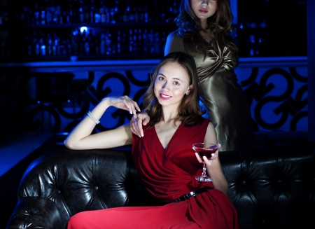 young woman has a rest with an alcoholic drink Stock Photo - 13628866