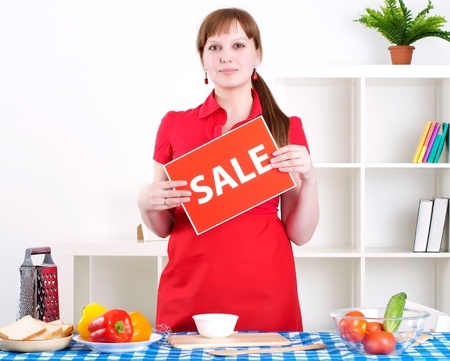 girl holding sale sign Stock Photo - 13667899