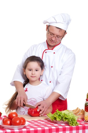 Father and daughter cooking together photo