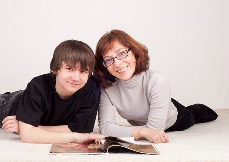 mother and son are together, read magazine Stock Photo - 13667900