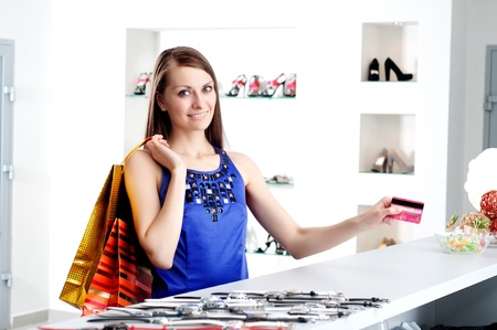 woman at shopping checkout paying credit card Stock Photo - 13805438