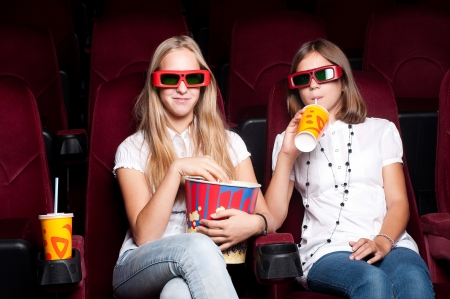 two girls look three-dimensional cinema photo
